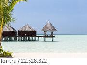 Купить «bungalow huts in sea water on exotic resort beach», фото № 22528322, снято 13 февраля 2016 г. (c) Syda Productions / Фотобанк Лори