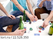 Купить «close up of male friends playing cards at home», фото № 22528350, снято 22 марта 2014 г. (c) Syda Productions / Фотобанк Лори