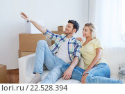 Купить «couple with boxes moving to new home and dreaming», фото № 22528394, снято 25 февраля 2016 г. (c) Syda Productions / Фотобанк Лори