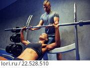 Купить «man and woman with barbell flexing muscles in gym», фото № 22528510, снято 19 апреля 2015 г. (c) Syda Productions / Фотобанк Лори