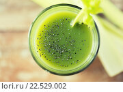 Купить «close up of fresh green juice glass and celery», фото № 22529002, снято 28 апреля 2015 г. (c) Syda Productions / Фотобанк Лори