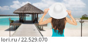 Купить «woman in swimsuit and sun hat from back on beach», фото № 22529070, снято 12 мая 2013 г. (c) Syda Productions / Фотобанк Лори