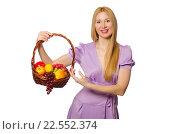 Купить «Blondie woman holding basket with fruits isolated on white», фото № 22552374, снято 12 апреля 2014 г. (c) Elnur / Фотобанк Лори