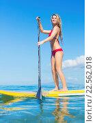 Купить «Attractive Woman on Stand Up Paddle Board, SUP, Tropical Blue Ocean, Hawaii», фото № 22562018, снято 19 ноября 2018 г. (c) easy Fotostock / Фотобанк Лори