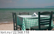 Купить «View on table and four chairs on coastline», видеоролик № 22568118, снято 5 февраля 2016 г. (c) Данил Руденко / Фотобанк Лори