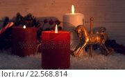 Купить «View of big candles burning next to christmas decorations», видеоролик № 22568814, снято 4 августа 2020 г. (c) Wavebreak Media / Фотобанк Лори