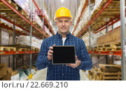Купить «happy businessman with tablet pc at warehouse», фото № 22669210, снято 7 марта 2015 г. (c) Syda Productions / Фотобанк Лори