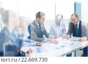 Купить «smiling business team at meeting», фото № 22669730, снято 9 ноября 2013 г. (c) Syda Productions / Фотобанк Лори