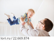 Купить «father with son playing and having fun at home», фото № 22669874, снято 19 марта 2016 г. (c) Syda Productions / Фотобанк Лори