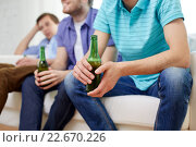happy male friends drinking beer at home. Стоковое фото, фотограф Syda Productions / Фотобанк Лори