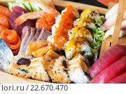 Купить «sushi set at restaurant», фото № 22670470, снято 13 февраля 2016 г. (c) Syda Productions / Фотобанк Лори