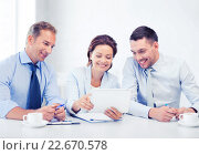 Купить «business team looking at tablet pc in office», фото № 22670578, снято 9 июня 2013 г. (c) Syda Productions / Фотобанк Лори
