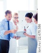 Купить «business team having discussion in office», фото № 22670586, снято 9 июня 2013 г. (c) Syda Productions / Фотобанк Лори