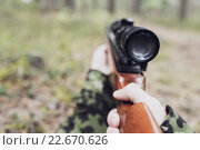 Купить «close up of soldier or hunter with gun in forest», фото № 22670626, снято 14 августа 2014 г. (c) Syda Productions / Фотобанк Лори