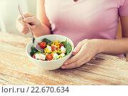 Купить «close up of young woman eating salad at home», фото № 22670634, снято 11 марта 2015 г. (c) Syda Productions / Фотобанк Лори
