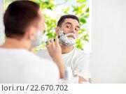 Купить «man shaving beard with razor blade at bathroom», фото № 22670702, снято 15 января 2016 г. (c) Syda Productions / Фотобанк Лори