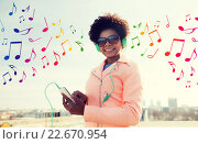 Купить «happy young woman with smartphone and headphones», фото № 22670954, снято 19 марта 2015 г. (c) Syda Productions / Фотобанк Лори