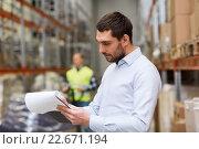 Купить «businessman writing to clipboard at warehouse», фото № 22671194, снято 9 декабря 2015 г. (c) Syda Productions / Фотобанк Лори