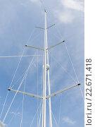 close up of sailboat mast over blue sky. Стоковое фото, фотограф Syda Productions / Фотобанк Лори