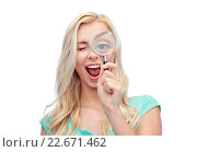 Купить «happy young woman with magnifying glass», фото № 22671462, снято 13 февраля 2016 г. (c) Syda Productions / Фотобанк Лори