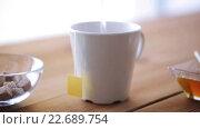Купить «tea bag and hot water pouring from kettle to cup», видеоролик № 22689754, снято 15 апреля 2016 г. (c) Syda Productions / Фотобанк Лори