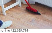 Купить «woman with broom cleaning floor at home», видеоролик № 22689794, снято 17 апреля 2016 г. (c) Syda Productions / Фотобанк Лори