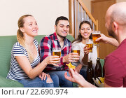 Купить «Smiling friends having fun», фото № 22690974, снято 17 февраля 2019 г. (c) Яков Филимонов / Фотобанк Лори