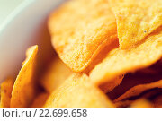 Купить «close up of corn crisps or nachos in bowl», фото № 22699658, снято 21 мая 2015 г. (c) Syda Productions / Фотобанк Лори