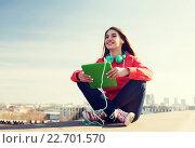 Купить «happy young woman with tablet pc and headphones», фото № 22701570, снято 19 марта 2015 г. (c) Syda Productions / Фотобанк Лори