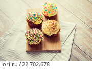 Купить «close up of glazed cupcakes or muffins on table», фото № 22702678, снято 21 мая 2015 г. (c) Syda Productions / Фотобанк Лори