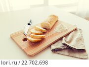 Купить «close up of white bread or baguette and knife», фото № 22702698, снято 22 мая 2015 г. (c) Syda Productions / Фотобанк Лори