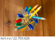 Купить «close up of stand or glass with pens and pencils», фото № 22703626, снято 17 марта 2016 г. (c) Syda Productions / Фотобанк Лори