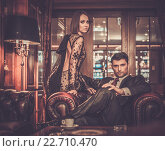 Купить «Elegant couple in formal dress in luxury cabinet interior», фото № 22710470, снято 26 мая 2013 г. (c) Andrejs Pidjass / Фотобанк Лори