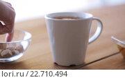Купить «hand adding sugar to cup of tea or coffee», видеоролик № 22710494, снято 15 апреля 2016 г. (c) Syda Productions / Фотобанк Лори