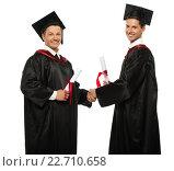 Купить «Cheerful young graduated student men shaking hands», фото № 22710658, снято 24 апреля 2014 г. (c) Andrejs Pidjass / Фотобанк Лори