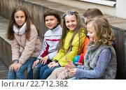 Купить «Junior kids chatting outdoor», фото № 22712382, снято 28 марта 2020 г. (c) Яков Филимонов / Фотобанк Лори