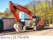 Excavator at construction site in summer sunny day, фото № 22716874, снято 26 апреля 2016 г. (c) FotograFF / Фотобанк Лори