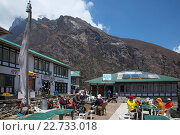 Купить «Asia, Nepal, Mount Everest, Dudhpokhari, Gokyo, Lodge, Tourist relaxing at restaurant with mountain in background», фото № 22733018, снято 21 августа 2019 г. (c) age Fotostock / Фотобанк Лори