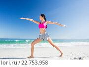 Купить «Woman doing yoga on the beach», фото № 22753958, снято 10 марта 2016 г. (c) Wavebreak Media / Фотобанк Лори