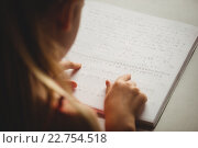 Купить «Girl using braille to read», фото № 22754518, снято 5 марта 2016 г. (c) Wavebreak Media / Фотобанк Лори