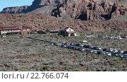 Купить «Parador Las Canadas del Teide with parking area is on the TF-24 road near the Roques Garcia in Teide National Park. Roques Garcia, Tenerife, Canary islands, Spain», видеоролик № 22766074, снято 18 февраля 2016 г. (c) Кекяляйнен Андрей / Фотобанк Лори