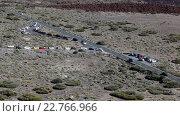Купить «Turn to the parking area and lower station of Teleferico cable car. Vehicles driving the road, top view. Teide volcano, Tenerife, Canary islands, Spain», видеоролик № 22766966, снято 18 февраля 2016 г. (c) Кекяляйнен Андрей / Фотобанк Лори