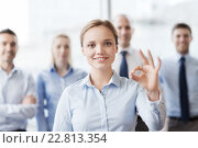 Купить «smiling businesswoman showing ok sign in office», фото № 22813354, снято 25 октября 2014 г. (c) Syda Productions / Фотобанк Лори