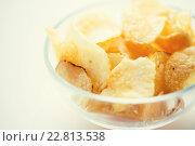 Купить «close up of crunchy potato crisps in glass bowl», фото № 22813538, снято 21 мая 2015 г. (c) Syda Productions / Фотобанк Лори