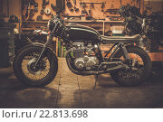 Купить «Vintage style cafe-racer motorcycle in customs garage», фото № 22813698, снято 4 февраля 2015 г. (c) Andrejs Pidjass / Фотобанк Лори