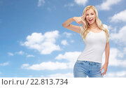 Купить «happy young woman or teenage girl in white t-shirt», фото № 22813734, снято 13 февраля 2016 г. (c) Syda Productions / Фотобанк Лори