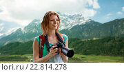 Купить «woman with backpack and camera over mountains», фото № 22814278, снято 25 июля 2015 г. (c) Syda Productions / Фотобанк Лори