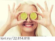Купить «happy woman having fun covering eyes with lime», фото № 22814818, снято 26 апреля 2015 г. (c) Syda Productions / Фотобанк Лори
