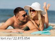 Купить «happy couple in swimwear lying on summer beach», фото № 22815054, снято 11 августа 2015 г. (c) Syda Productions / Фотобанк Лори