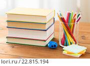 Купить «close up of crayons or color pencils and books», фото № 22815194, снято 17 марта 2016 г. (c) Syda Productions / Фотобанк Лори